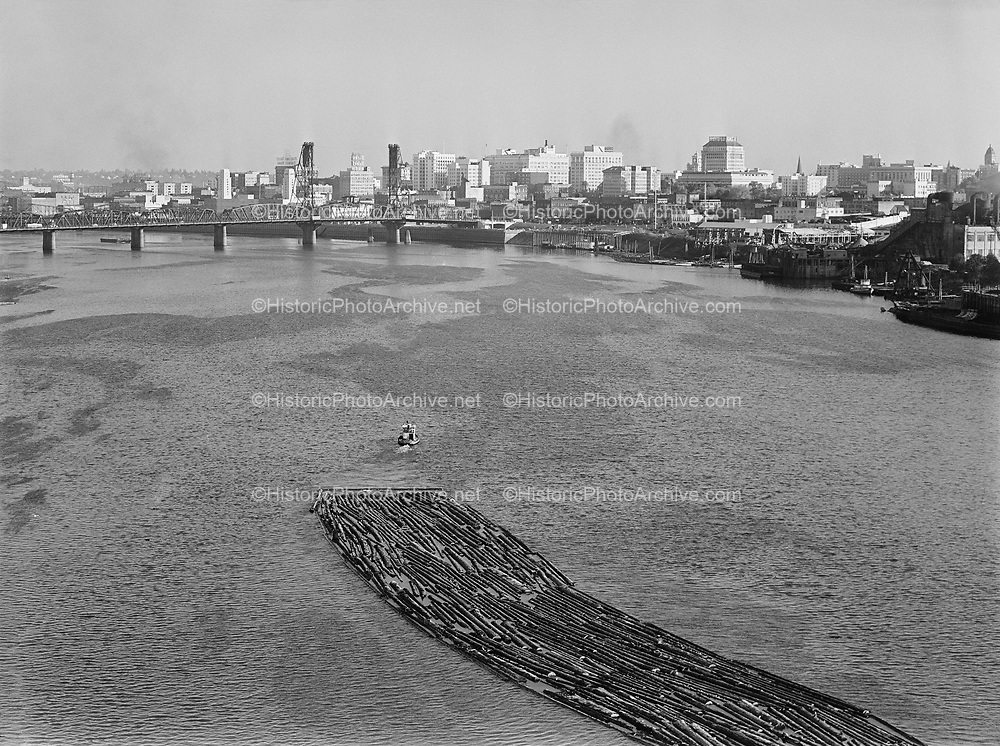 9969-7354. Portland from Ross Island Bridge, with log raft in foreground. October 11, 1948.