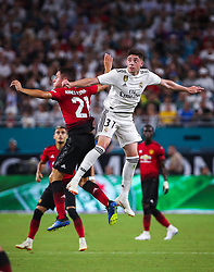 July 31, 2018 - Miami Gardens, Florida, USA - Real Madrid C.F. midfielder Federico Valverde (37) (right) and Manchester United F.C. midfielder Ander Herrera (21) (left) follow the ball, after disputing a header in midair, during an International Champions Cup match between Real Madrid C.F. and Manchester United F.C. at the Hard Rock Stadium in Miami Gardens, Florida. Manchester United F.C. won the game 2-1. (Credit Image: © Mario Houben via ZUMA Wire)
