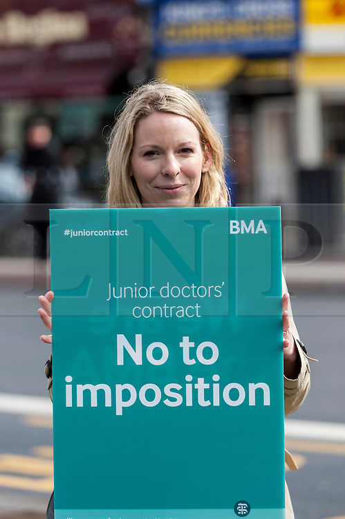 """© Licensed to London News Pictures. 06/04/2016. London, UK. Junior doctors hold an event outside King's Cross station for the public to """"meet the doctors"""" as they stage the fourth strike against changes to contracts. Photo credit : Stephen Chung/LNP"""