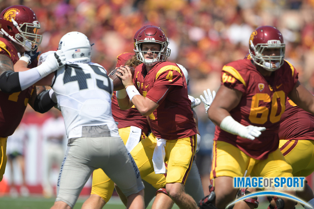 Sep 10, 2016; Los Angeles, CA, USA; USC Trojans quarterback Max Browne (4) throws a pass against the Utah State Aggies during a NCAA football game at Los Angeles Memorial Coliseum.