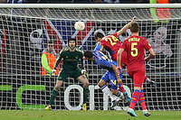 Chelsea's Ryan Bertrand (C) vies with Steaua Bucharest's Raul Rusescu (R) during the first leg of the UEFA Europa League round of 16 football match between Steaua Bucharest and Chelsea at the National Arena Stadium in Bucharest on March 7, 2013.