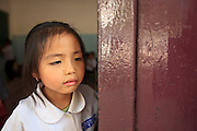 Mar. 10, 2009 -- VIENTIANE, LAOS: A girl stands in the door of her classroom at an elementary school in Vientiane, Laos.  Photo by Jack Kurtz / ZUMA Press