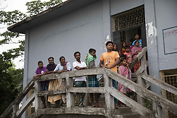 May 4, 2019 - Khulna, Bangladesh - Bangladeshi people waits in front of a cyclone center in Khulna, Pan Khali on May 4, 2019, as Cyclone Fani reached Bangladesh. Cyclone Fani, one of the biggest to hit India in years, barrelled into Bangladesh on May 4 after leaving a trail of deadly destruction in India. (Credit Image: © Ahmed Salahuddin/NurPhoto via ZUMA Press)