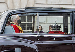 Licensed to London News Pictures. 11/05/2021. London, UK. The Crown Jewels guarded in the back of a Rolls Royce drives down Whitehall, London as it heads to Westminster Palace for the State opening of Parliament. Photo credit: Alex Lentati/LNP