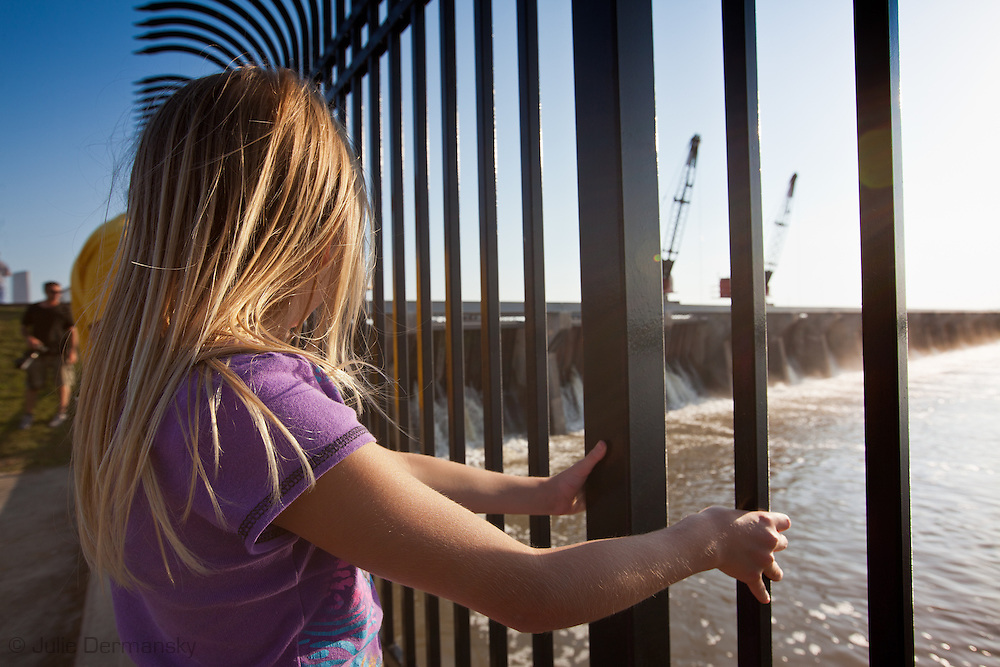 The Bonnet Carre Spillway  in Norco, Louisiana   protects New Orleans from flood waters of the Mississippi River by controlling the rivers flow will be opened by The Army Corps of Engineers on May 9th . The Spillway  was built after the 1927 flood and is only opened when the river gets dangerously high.///People visit the Bonnet Carre Spillway and watch water cascade over the top of it from the dangerously high Mississippi River that is causing flooding in Memphis Tennessee and other areas along the rivers banks.
