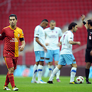 Galatasaray's Arda TURAN (L) during their Turkish superleague soccer derby match Galatasaray between Trabzonspor at the TT Arena in Istanbul Turkey on Sunday, 10 April 2011. Photo by TURKPIX