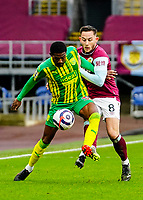 West Bromwich Albion's Ainsley Maitland-Niles shields the ball from Burnley's Josh Brownhill<br /> <br /> Photographer Lee Parker/CameraSport<br /> <br /> The Premier League - Burnley v West Bromwich Albion - Saturday 20th February 2021 - Turf Moor - Burnley<br /> <br /> World Copyright © 2021 CameraSport. All rights reserved. 43 Linden Ave. Countesthorpe. Leicester. England. LE8 5PG - Tel: +44 (0) 116 277 4147 - admin@camerasport.com - www.camerasport.com