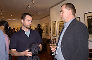 Tim Garland and theo Garland, Nicholas Garland prints and drawings, Fine Art Society. 13 May 2003. © Copyright Photograph by Dafydd Jones 66 Stockwell Park Rd. London SW9 0DA Tel 020 7733 0108 www.dafjones.com
