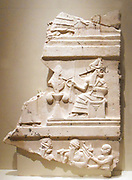 Fragment section of the Ur Namma Stele. Akkadian, Mesopotamia, Ur. 2397-2080 BC Reign of Ur Namma. The stele is the only surviving monument from the Ur III period and illustrates aspects of kingship. It depicts a seated god offering symbols of power to a king.
