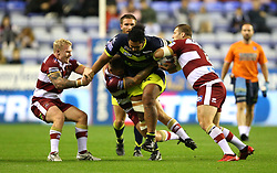 Wigan Warriors Gabriel Hamlin (left) and Tony Club (right) tackle Wakefield Trinity's Pauli Pauli during the Betfred Super League Super 8's match at the DW Stadium, Wigan. PRESS ASSOCIATION Photo. Picture date: Thursday September 6, 2018. See PA story RUGBYL Wigan. Photo credit should read: Nigel French/PA Wire. RESTRICTIONS: Editorial use only. No commercial use. No false commercial association. No video emulation. No manipulation of images.