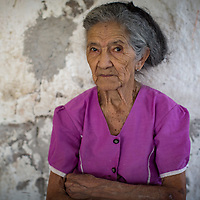 """Jesus the Midwife<br /> <br /> María de Jesús Pérez Vásquez<br /> Coalaca, Las Flores, Lempira<br /> <br /> """"I'm 92, I was born in 1925. I had three of my own children, two boys and a girl. I spend most of my time in the house nowadays, with my daughter-in-law and grandchildren.<br /> <br /> There's no one else my age around here. The secret to a long life is to rest enough but not too much, eat as little as a child eats and work hard. I still like to make tortillas, though my fingers are getting stiff now.<br /> <br /> My parents didn't have money to send me to school, but I learned a few things. I worked as a midwife for 60 years. I delivered a lot of babies, attended a lot of women in birth. Everyone here knows me. Women still bring me little gifts to say thank you. When I walk down the road, most of the people I meet I saw them arrive in this world. I was the first person to hold them.<br /> <br /> My husband was a drunk. He died of a hangover in a field 12 years after we got married. I brought up the children on my own."""""""