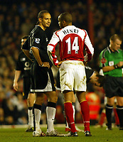 Fotball<br /> England 2004/2005<br /> Foto: SBI/Digitalsport<br /> NORWAY ONLY<br /> <br /> Arsenal v Manchester United<br /> Barclays Premiership. 01/02/2005<br /> <br /> Friends Rio Ferdinand and Thierry Henry share a joke