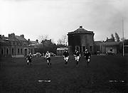 Irish Rugby Football Union, Ireland v Wales, Five Nations, Irish team practice, Dublin, Ireland, Friday 14th March, 1958,.14.3.1958, 3.14.1958,. . Irish Team, ..J G M W Murphy, Wearing number 15 Irish jersey, Full Back, London Irish Rugby Football Club, Surrey, England, ..A J O'Reilly, Wearing number 14 Irish jersey, Right Wing, Old Belvedere Rugby Football Club, Dublin, Ireland,  ..N J Henderson, Wearing number 13 Irish jersey, Captain of the Irish team, Right centre, N.I.F.C, Rugby Football Club, Belfast, Northern Ireland, ..D Hewitt, Wearing number 12 Irish jersey, Left centre, Queens University Rugby Football Club, Belfast, Northern Ireland,..A C Pedlow, Wearing number 11 Irish jersey, Left wing,  C I Y M S Rugby Football Club, Belfast, Northern Ireland, ..M A English, Wearing number 10 Irish jersey, Outside Half, Bohemians Rugby Football Club, Limerick, Ireland, ..J A O'Meara, Wearing number 9 Irish jersey, Scrum Half, Dolphin Rugby Football Club, Cork, Ireland, ..P J O'Donoghue, Wearing  Number 1 Irish jersey, Forward, Bective Rangers Rugby Football Club, Dublin, Ireland, ..A R Dawson, Wearing number 2 Irish jersey, Forward, Wanderers Rugby Football Club, Dublin, Ireland, . .B G Wood, Wearing number 3 Irish jersey, Forward, Garryowen Rugby Football Club, Limerick, Ireland, ..J B Stevenson, Wearing number 4 Irish jersey, Forward, Instonians Rugby Football Club, Belfast, Northern Ireland,..W A Mulcahy, Wearing number 5 Irish jersey, Forward, University College Dublin Rugby Football Club, Dublin, Ireland, ..J A Donaldson, Wearing number 6 Irish jersey, Forward, Collegians Rugby Football Club, Belfast, Northern Ireland, ..J R Kavanagh, Wearing number 7 Irish jersey, Forward, Wanderers Rugby Football Club, Dublin, Ireland, ..N A Murphy, Wearing number 8 Irish jersey, Forward, Cork Constitution Rugby Football Club, Cork, Ireland,.
