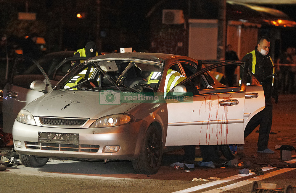 April 28, 2018 - Kiev, Ukraine - Ukrainian police officers investigate the scene of a grenade explosion within a car, in Kiev, Ukraine. According to local media reports, one unidentified man was killed and another one injured after a grenade exploded inside of a car. (Credit Image: © Serg Glovny via ZUMA Wire)
