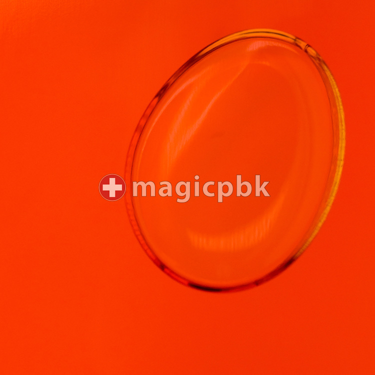Bubbles seen in an Aura-Soma Equilibrium no. 26 (B26, Orange / Orange, Etheric Rescue / Humpty Dumpty) during a studio product photo session held at Aura-Soma Germany in Heiligenhaus, Germany, Monday, Sept. 15, 2014. (Photo by Patrick B. Kraemer / MAGICPBK)