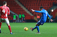 AFC Wimbledon midfielder Tom Soares (19) with a shot on goal during the EFL Sky Bet League 1 match between Charlton Athletic and AFC Wimbledon at The Valley, London, England on 15 December 2018.