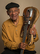 Musician and Wheatley High School graduate La La Wilson poses for a photograph with his favorite bass guitar, February 6, 2015.