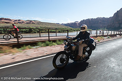 Craig Jackman riding his 1936 HD VLH Twin Carb on Utah Highway 128 north of Moab during stage 11 (289 miles) of the Motorcycle Cannonball Cross-Country Endurance Run, which on this day ran from Grand Junction, CO to Springville, UT., USA. Tuesday, September 16, 2014.  Photography ©2014 Michael Lichter.