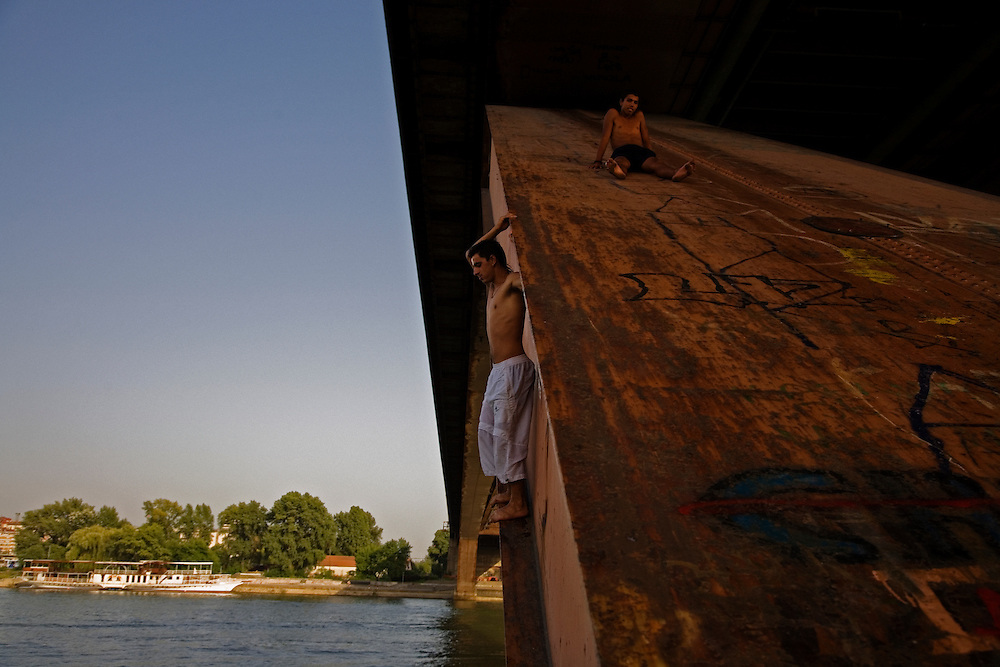 Boys and teenagers playing on the foundation of the Gazela Bridge over the Sava River near the Nova Gazela camp. Preparing to dive in.