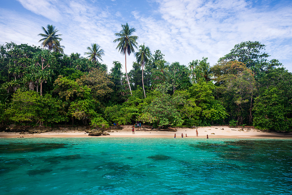 Papua New Guineans visit the beach on Pig Island, a small island located near the town of Madang in Papua New Guinea.<br /><br />(August 1, 2017)