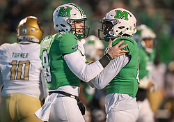 Dec 18, 2020; Huntington, West Virginia, USA; Marshall Thundering Herd quarterback Grant Wells (8) celebrates after a touchdown pass with Marshall Thundering Herd tight end Xavier Gaines (11) during the third quarter against the UAB Blazers at Joan C. Edwards Stadium. Mandatory Credit: Ben Queen-USA TODAY Sports