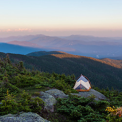 A tent perched on a ledge near the summit of South Kinsman Mountain in New Hampshire's White Mountains.