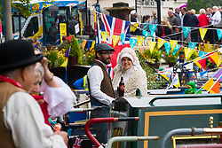 Little Venice, London, April 30th 2017. Narrowboaters from all over the UK gather for the annual Canalway Cavalcade, held on the May Day Bank holiday weekend, organised by the Inland Waterways Association, where boaters get the chance to display their immaculately prepared and brightly painted craft as well as compete in various manoeuvring tests. PICTURED: Narrowboaters in period dress chat on their boats.