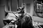 A nurse examines a patient being monitored for the coronavirus disease (COVID-19) in the emergency unit at the Saint-Pierre University Hospital Brussels, April 22, 2020.
