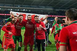 Aaron Ramsey of Wales, Wayne Hennessey, Gareth Bale and Joe Ledley pose for photos as they celebrate Qualifying for Euro 2016  - Mandatory byline: Dougie Allward/JMP - 07966 386802 - 13/10/2015 - FOOTBALL - Cardiff City Stadium - Cardiff, Wales - Wales v Andorra - European Qualifier 2016 - Group B