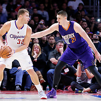 08 December 2014: Phoenix Suns center Alex Len (21) defends on Los Angeles Clippers forward Blake Griffin (32)  during the Los Angeles Clippers 121-120 overtime victory over the Phoenix Suns, at the Staples Center, Los Angeles, California, USA.