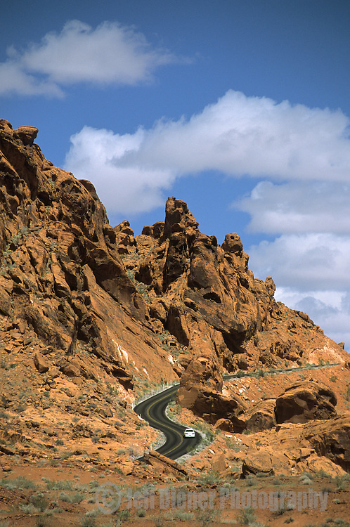 A car drives a windy road through the Valley of Fire State Park, Nevada.