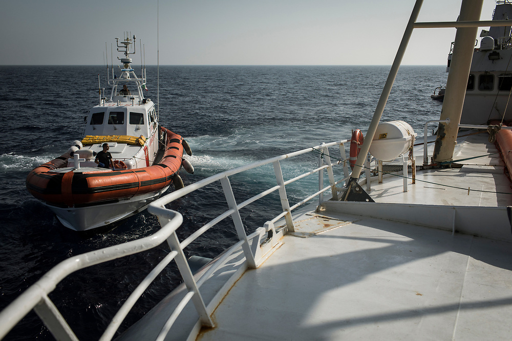 June 29th, 2017, Central Mediterranean. Italian Coast Guard came to see the situation after hours and realized that they were not prepared to handel the situation. Evacuation of Samuel Osei, a 36-year-old man from Ghana severely sick after being rescued in the sea. NGO Proactiva Open Arms in their 20th rescue mission in the Central Mediterranean Sea on board of Golfo Azzurro vessel (photo Edu Bayer)