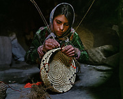 Making wicker basket by hand. The traditional life of the Wakhi people, in the Wakhan corridor, amongst the Pamir mountains.