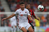 Football - 2019 / 2020 Premier League - AFC Bournemouth vs. Sheffield United<br /> <br /> John Egan of Sheffield United and Bournemouth's Callum Wilson keep an eye on the ball at the Vitality Stadium (Dean Court) Bournemouth <br /> <br /> COLORSPORT/SHAUN BOGGUST