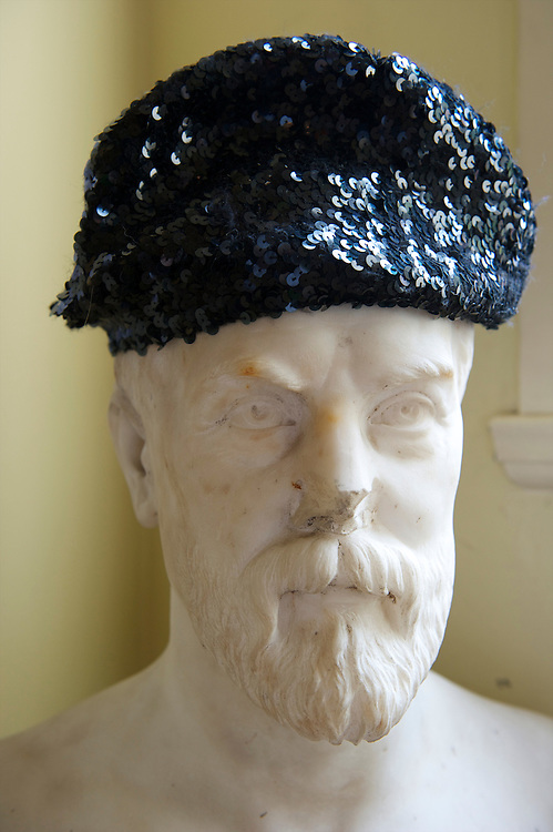 A sequined hat adorns a marble bust during the Saloni autumn/spring 2010/2011 show held in the map room of the Royal Geographical Society, South Kensington, London on 20 September 2010.