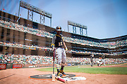 Pittsburgh Pirates center fielder Andrew McCutchen (22) gets warm in the on-deck circle during the first inning against the San Francisco Giants at AT&T Park in San Francisco, Calif., on August 17, 2016. (Stan Olszewski/Special to S.F. Examiner)