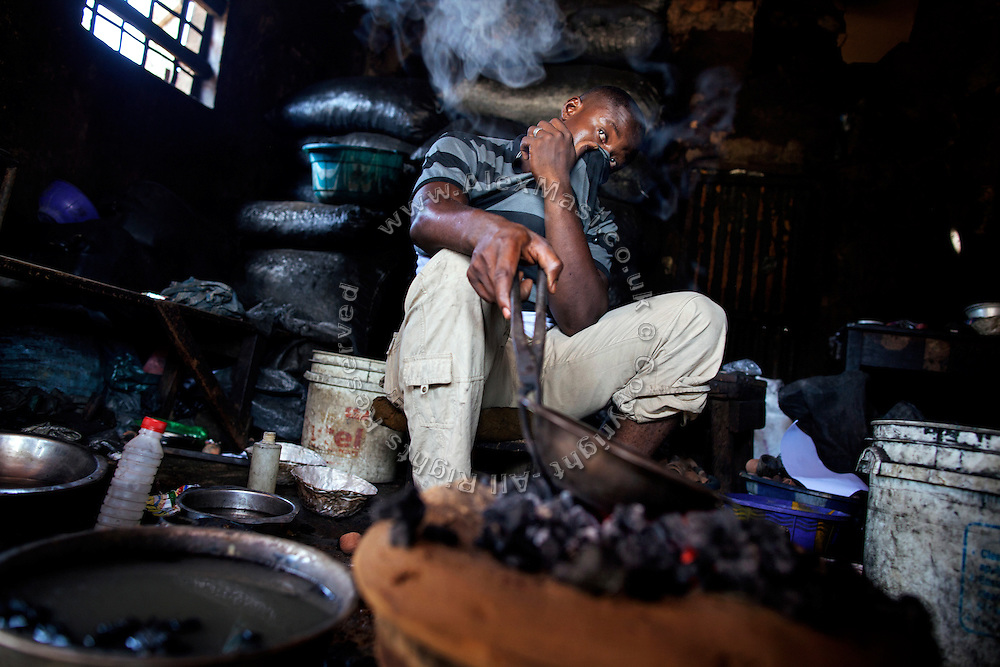 A goldsmith in Gusau, capital of Zamfara State, Nigeria, is burning sulphuric acid and gold, in order to remove last impurities. The lead contamination in artisanal gold extraction is caused by ingestion and breathing of lead particles released in the steps to isolate the gold from other metals. This type of lead is soluble in stomach acid and children under-5 are most affected, as they tend to ingest more through their hands by touching the ground, and are developing symptoms often leading to death or serious disabilities.