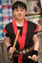 Asia, Japan, Honshu island, Kanagawa Prefecture, Kamakura, Tsurugaoka Hachimangu shrine, boy playing taiko drums during festival