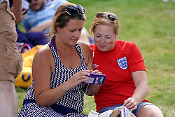 Tennis fans watch the England football World Cup quarter final match against Sweden on a phone on day six of the Wimbledon Championships at the All England Lawn Tennis and Croquet Club, Wimbledon. PRESS ASSOCIATION Photo. Picture date: Saturday July 7, 2018. See PA story TENNIS Wimbledon. Photo credit should read: John Walton/PA Wire. RESTRICTIONS: Editorial use only. No commercial use without prior written consent of the AELTC. Still image use only - no moving images to emulate broadcast. No superimposing or removal of sponsor/ad logos. Call +44 (0)1158 447447 for further information.