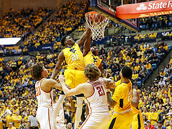 Jan 20, 2018; Morgantown, WV, USA; West Virginia Mountaineers forward Wesley Harris (21) and West Virginia Mountaineers guard Daxter Miles Jr. (4) help put a basket in during a rebound during the second half against the Texas Longhorns at WVU Coliseum. Mandatory Credit: Ben Queen-USA TODAY Sports