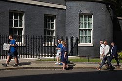 London, UK. 20th July, 2021. NHS workers from the grassroots NHSPay15 campaign, supported by MPs Jeremy Corbyn, Ian Byrne and Lloyd Russell-Moyle, arrive in Downing Street to present a petition signed by over 800,000 people calling for a 15% pay rise for NHS workers. At the time of presentation of the petition, the government was believed to be preparing to offer NHS workers a 3% pay rise in 'recognition of the unique impact of the pandemic on the NHS'.