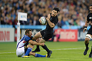 Nehe Milner-Skudder of New Zealand is tackled by Johan Tromp of Namibia. Rugby World Cup 2015 pool C match, New Zealand v Namibia at Olympic Stadium in London on Thursday 24th September 2015.<br /> pic by John Patrick Fletcher, Andrew Orchard sports photography.