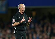 Referee Mike Dean holds a 2 and a 1 up during the Premier League match at the Stamford Bridge Stadium, London. Picture date: April 5th, 2017. Pic credit should read: David Klein/Sportimage
