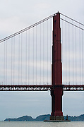 San Francisco California USA, Golden Gate Bridge as seen from below from the SF bay on board a tour boat October 2006