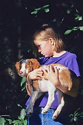 Norah Holding Brittany Spaniel