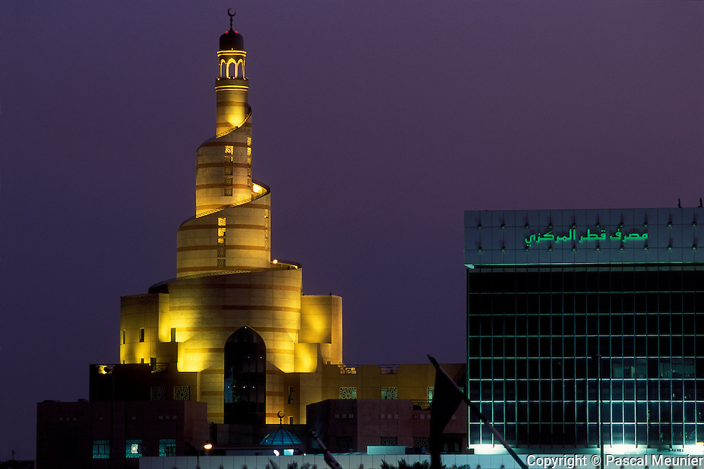 QATAR. Doha. Islamic arts centre and national Qatari bank...Built on the model of the most famous mosque of Samara in Iraq, this mosque shelters the islamic art centre, in which anyone, even non moslems, can come to get information on the religion. Beside it, in the modern building, the national Qatari bank..