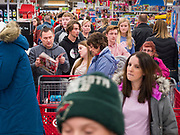"28 NOVEMBER 2019 - ANKENY, IOWA: Shoppers crowd an aisle between the electronics and toy departments at the Target store in Ankeny, Iowa, Thursday evening. ""Black Friday"" is the unofficial start of the Christmas holiday shopping season and has traditionally thought to be one of the busiest shopping days of the year. Brick and mortar retailers, like Target, are facing increased pressure from online retailers this year. Many retailers have started opening on Thanksgiving Day. Target stores across the country opened at 5PM on Thanksgiving to attract shoppers with early ""Black Friday"" specials.    PHOTO BY JACK KURTZ"