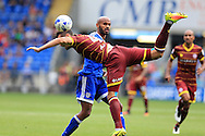 Frederic Gounongbe  of Cardiff city © is challenged by Grant Hall of Queens Park Rangers.  EFL Skybet championship match, Cardiff city v Queens Park Rangers at the Cardiff city stadium in Cardiff, South Wales on Sunday 14th August 2016.<br /> pic by Andrew Orchard, Andrew Orchard sports photography.