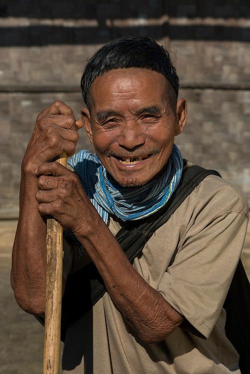 Ao Naga Man wearing traditional haircut<br /> Ao Naga Headhunting Tribe<br /> Mokokchung district<br /> Nagaland,  ne India