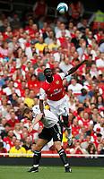 Photo: Steve Bond.<br />Arsenal v Derby County. The FA Barclays Premiership. 22/09/2007. Kolo Toure rises above Steve Howard